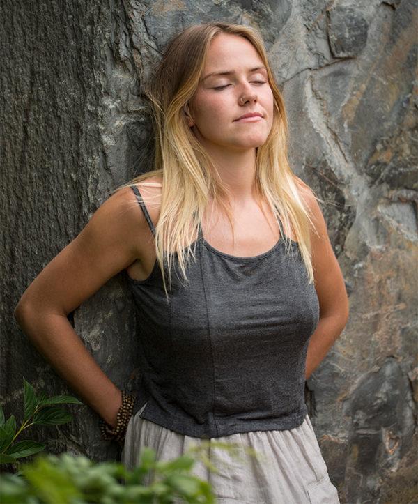 Josie leResiliance program girl leaning on rock